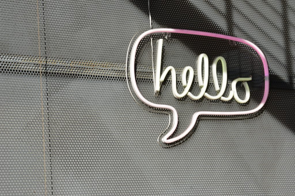 Image of a neon sign that says 'hello'