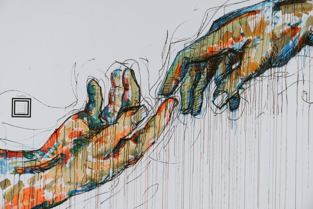 Artwork of two hands lightly touching